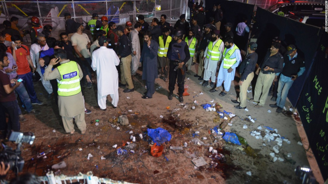 Rescuers and officials gather at the site of the blast.