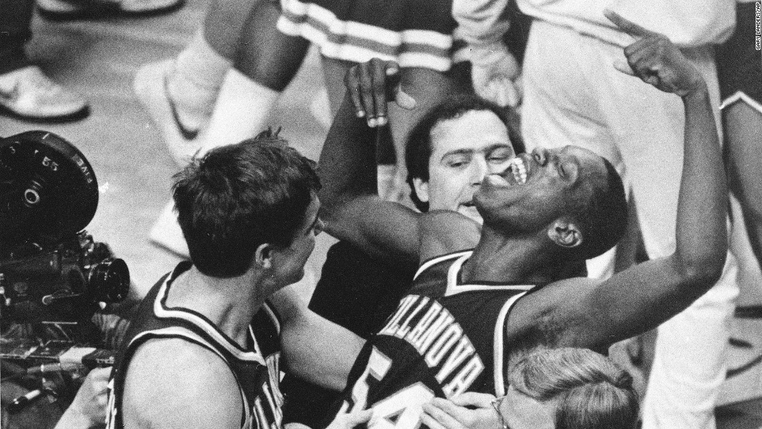 In the first year that the NCAA tournament expanded to 64 teams, No. 8 seed Villanova, led by Most Outstanding Player Ed Pinckney (center), emerged as the unlikely champion, defeating No. 1 Georgetown 66-64 in the title game, one of the biggest upsets in U.S. sports history. The Wildcats reached the Final Four with a win against No. 2 North Carolina and then defeated No. 2 Memphis to reach the national championship game.