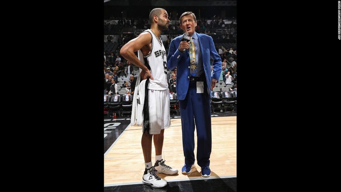 Sager has made a name for himself with his often flamboyant clothes. Here he interviews Tony Parker of the San Antonio Spurs during a game against the Chicago Bulls.