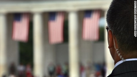 A Secret Service agent scans the crowd at the amphitheater of the Arlington National Cemetery on Memorial Day May 28, 2007 in Virginia.