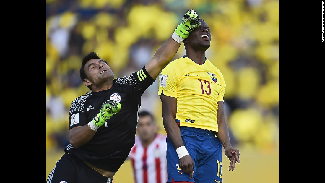 Paraguay goalkeeper Justo Villar punches the ball near Ecuador's Enner Valencia during a World Cup qualifying match on Thursday, March 24. The teams tied 2-2 in Quito, Ecuador.