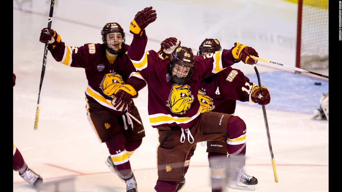 Karson Kuhlman, center, celebrates Friday, March 25, after his goal in double overtime lifted Minnesota-Duluth to the quarterfinals of the NCAA Tournament. The Bulldogs defeated Providence, the defending national champions, by a 2-1 score.