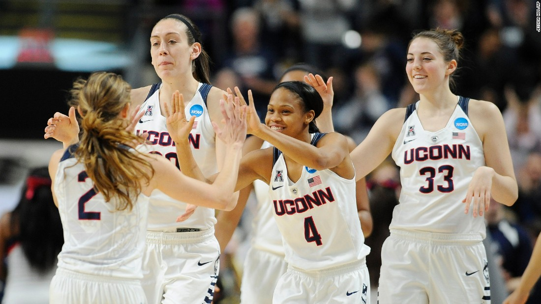 Connecticut basketball players -- from left, Briana Pulido, Breanna Stewart, Moriah Jefferson and Katie Lou Samuelson -- celebrate after thrashing Mississippi State in the NCAA Tournament on Saturday, March 26. The undefeated Huskies won 98-38, a record margin of victory for the Sweet 16. UConn has won the last three NCAA titles.