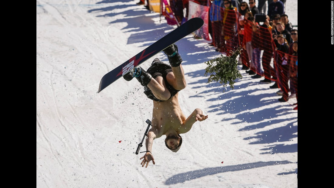 A snowboarder performs during the Red Bull Jump and Freeze competition near Almaty, Kazakhstan, on Tuesday, March 22.