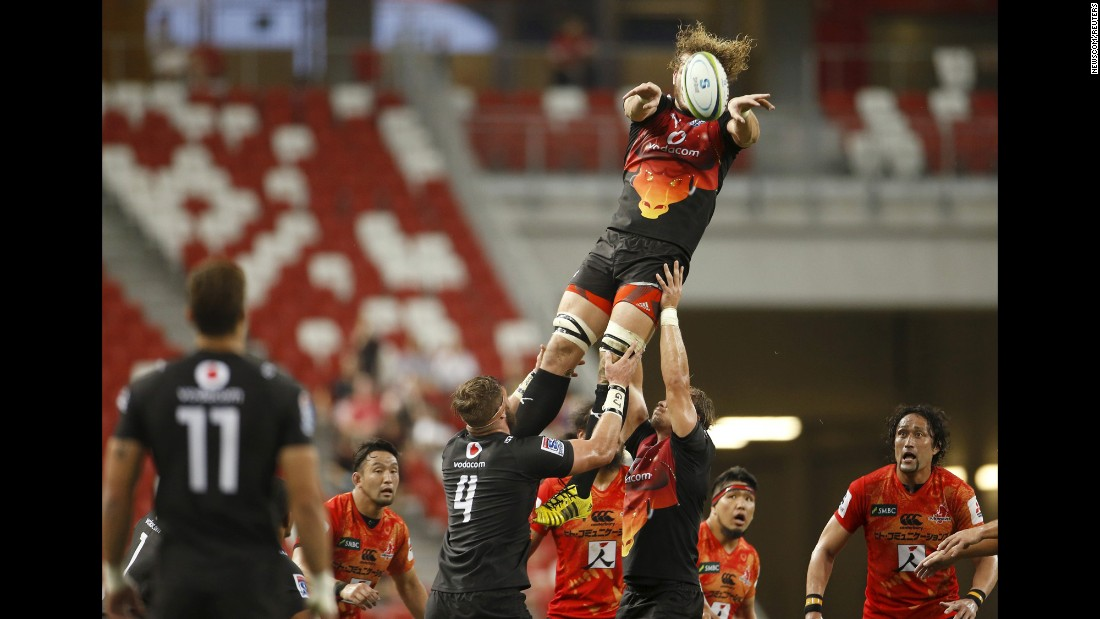 RG Snyman, a rugby player with the Bulls, is lifted by his teammates Saturday, March 26, during a Super Rugby match against the Sunwolves in Singapore. The Bulls are based in Pretoria, South Africa. The Sunwolves hail from Tokyo.
