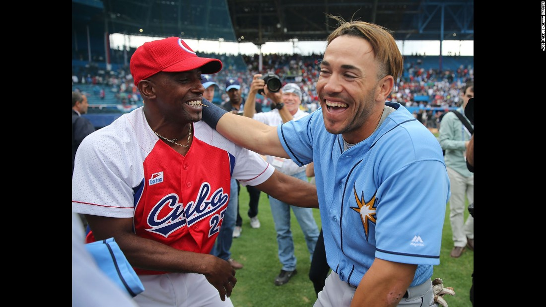 "Dayron Varona, right, hugs members of the Cuban national team after he and the Tampa Bay Rays played an exhibition game in Havana, Cuba, on Tuesday, March 22. Varona defected from Cuba in 2013 and was called up by the Rays to play in the historic game. <a href=""http://www.cnn.com/2016/03/20/americas/gallery/obama-cuba-visit/index.html"" target=""_blank"">U.S. President Barack Obama</a> was in attendance. <a href=""http://www.cnn.com/2016/03/22/sport/gallery/what-a-shot-sports-0322/index.html"" target=""_blank"">See 33 amazing sports photos from last week</a>"