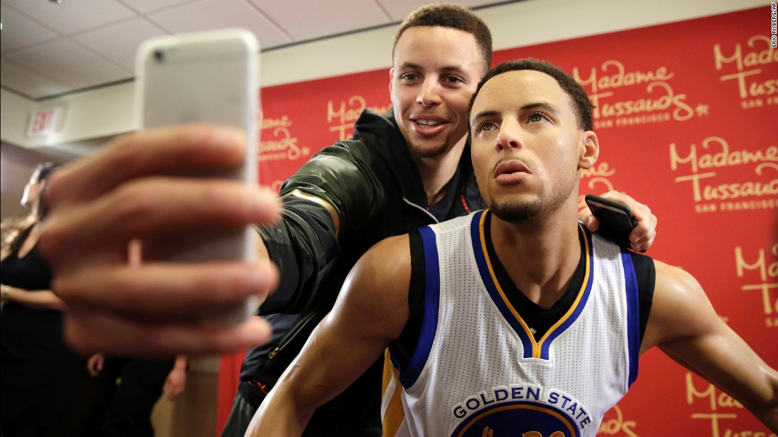 NBA star Stephen Curry takes a selfie with his wax figure after it was unveiled in Oakland, California, on Thursday, March 24. The figure will be displayed at a Madame Tussauds in San Francisco.