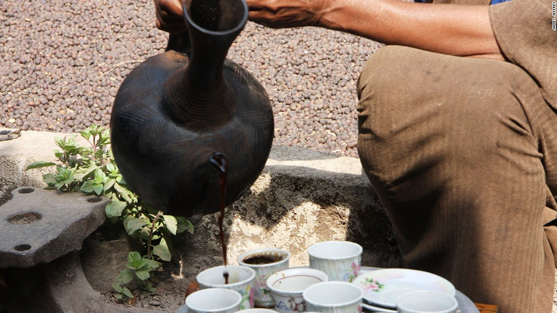 At a local forest homestead a woman makes coffee using a jebena clay pot, the traditional method.