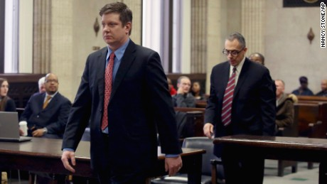 Van Dyke approaches the bench during a March procedural hearing.