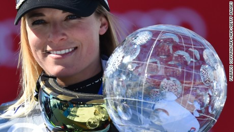 Switzerland's Lara Gut holds the Ladies' crystal globe trophy on the podium of the FIS Alpine Skiing World Cup in St Moritz on March 20, 2016.  AFP PHOTO / FABRICE COFFRINI / AFP / FABRICE COFFRINI        (Photo credit should read FABRICE COFFRINI/AFP/Getty Images)