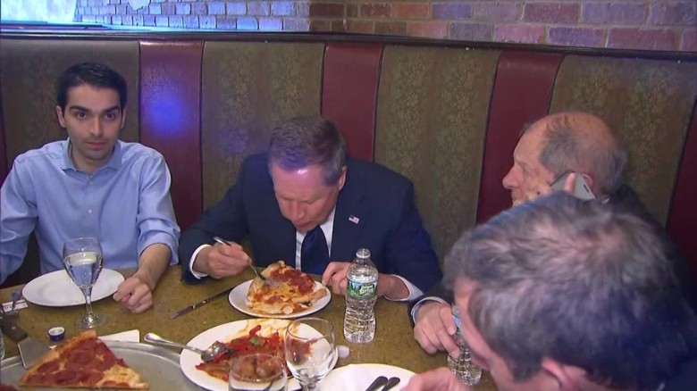 John Kasich eats pizza with fork in new york_00000000