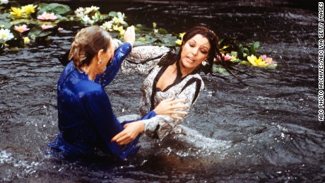 "UNITED STATES - APRIL 13:  DYNASTY - ""The Threat"" - Season Three - 4/13/83, Krystle (Linda Evans) and Alexis's (Joan Collins) argument about Fallon resulted in a brawl in the Carrington lily pond.,  (Photo by ABC Photo Archives/ABC via Getty Images)"