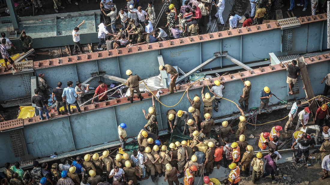 Rescue workers and volunteers try to free people on March 31.