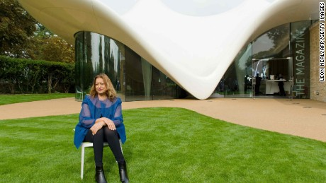 (FILES) A file photo taken on September 25, 2013, shows Iraqi-British architect Zaha Hadid posing for pictures outside her recently completed design for an extension of the Serpentine Sackler Gallery in London. Iraqi-British architect Zaha Hadid, whose works include the London Aquatics Centre used in the 2012 Olympics, died on Thursday from a heart attack aged 65, her company said.  / AFP PHOTO / LEON NEALLEON NEAL/AFP/Getty Images