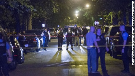 Chicago police at a shooting scene where five people were reported to have been shot, including an 11-month-old , in September  2015.