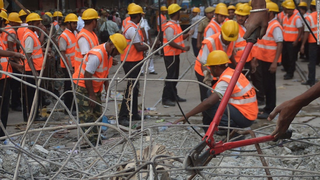 Rescue workers cut rebar and clear debris  while looking for people trapped under the wreckage on April 1.