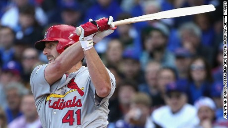 John Lackey of the St. Louis Cardinals breaks his bat as he hits a single in the second inning against the Chicago Cubs during game four of the National League Division Series on October 13, 2015 in Chicago, Illinois