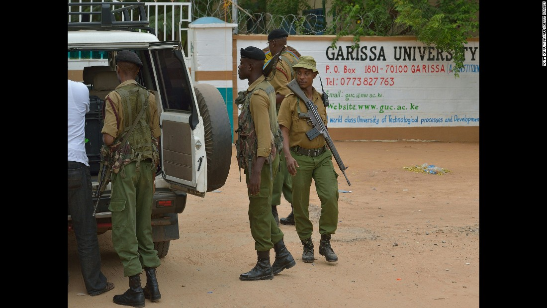 Security officers conduct a search on a vehicle arriving at the school.  A police station has been set up at the school and security has been increased from four officers to 30.