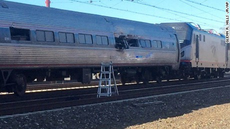 This photo shows an Amtrak train following an accident Sunday, April 3, 2016, in Chester, Pa. Amtrak said the train was heading from New York to Savannah, Ga., when it struck a backhoe outside of Philadelphia. (Glenn R. Hills Jr via AP) MANDATORY CREDIT