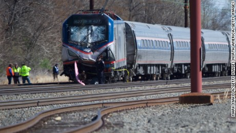 Emergency crews investigate the site of Sunday's Amtrak train crash near Philadelphia.