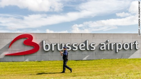 A policeman patrols at Brussels Airport, in Zaventem, Belgium, Sunday, April 3, 2016. Under extra security, three Brussels Airlines flights, the first for Faro in Portugal, are scheduled to leave Sunday from an airport that used to handle about 600 flights a day. (AP Photo/Geert Vanden Wijngaert)