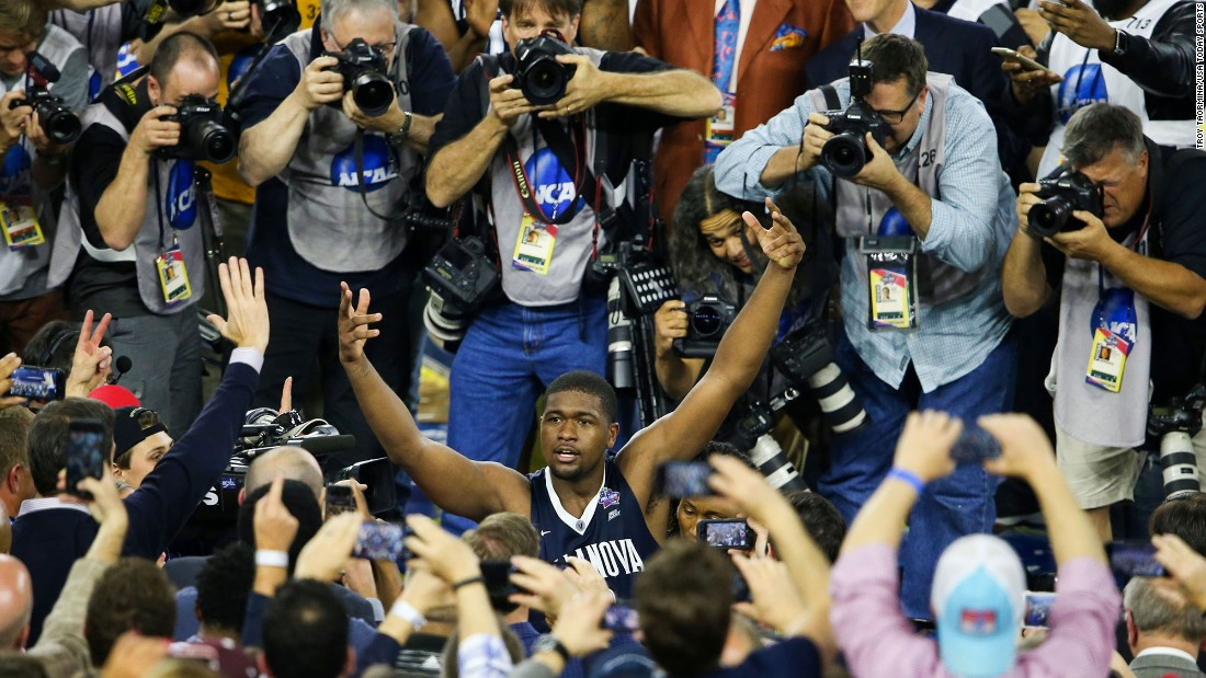 Jenkins celebrates amid a throng of fans and media. It is the second national championship for Villanova, which also won the title in 1985.