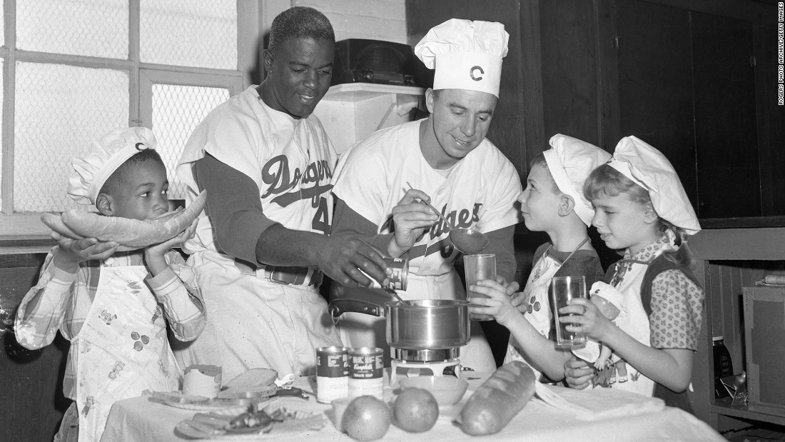 "Dodgers shortstop and native Kentuckian Pee Wee Reese was a supporter of Robinson in the latter's first rough year in the majors, refusing to sign a petition from teammates for a boycott and -- <a href=""http://espn.go.com/blog/playbook/fandom/post/_/id/20917/did-reese-really-embrace-robinson-in-47"" target=""_blank"">according to some stories</a> -- showing his solidarity by putting his arm around Robinson's shoulders. He became one of Robinson's best friends. The two are pictured in 1950 with their children, cooking soup."