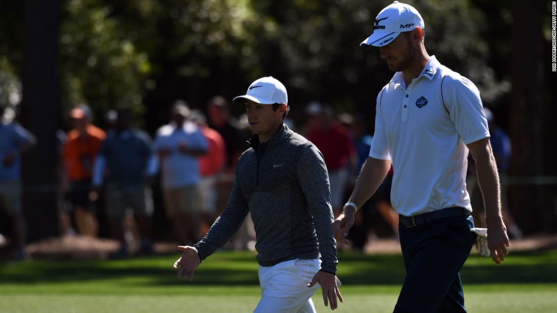 "Rory McIlroy (left) with practice partner Chris Wood, who reflected: ""When he closes out with a hole in one, you can't really do a lot about that."""
