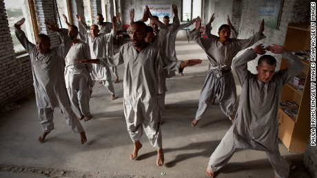 Drug addicts exercise at a rehab center in Kabul.