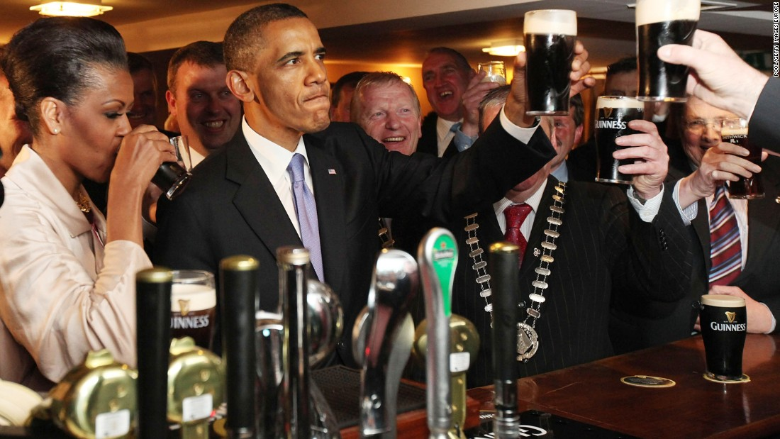 Obama and first lady Michelle Obama enjoy a glass of Guinness in his ancestral home of Moneygall, Ireland, in May 2011.
