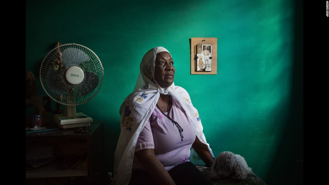 Fatima, seen in her bedroom with an image of Jesus Christ in the background, is the only Muslim in her family.