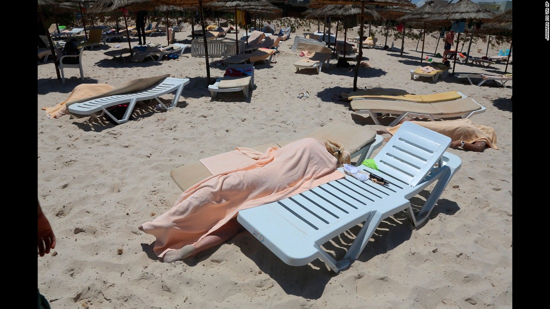 "Dead bodies lie near a beachside hotel in Sousse, Tunisia, after <a href=""http://www.cnn.com/2015/06/26/world/gallery/tunisia-terrorist-attack/index.html"" target=""_blank"">a gunman opened fire</a> on June 26, 2015. ISIS claimed responsibility for the attack, which killed at least 38 people and wounded at least 36 others, many of them Western tourists. Two U.S. officials said they believed the attack might have been inspired by ISIS but not directed by it."