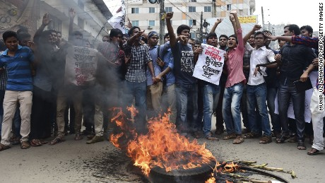 Bangladeshi students block the road and stage a protest following the murder of a law student, hacked to death by four assailants the night before, in Dhaka on April 7, 2016. A Bangladeshi law student who posted against Islamism on his Facebook page has been murdered, police said on April 7, the latest in a series of killings of secular activists and bloggers in the country. / AFP / Munir UZ ZAMAN        (Photo credit should read MUNIR UZ ZAMAN/AFP/Getty Images)