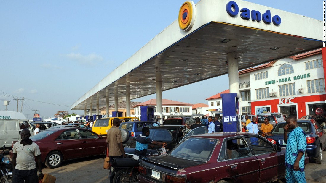 People wait in line to buy fuel at a gas station in Lagos on March 9, 2016, due to an ongoing fuel scarcity crisis in Nigeria.