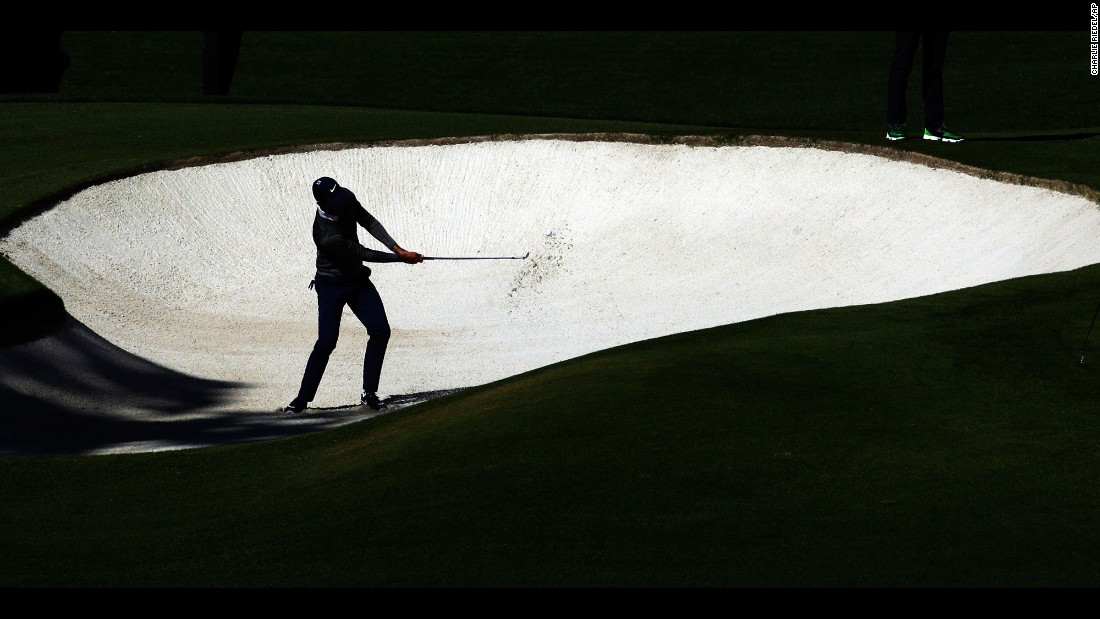 Charl Schwartzel hits out of a bunker on April 8. Schwartzel won the Masters in 2011.