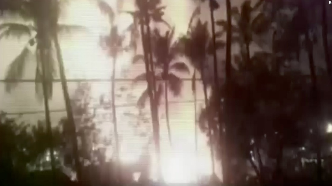 In this image made from video, a flash from an explosion is seen from the ground during a fireworks show at the temple.