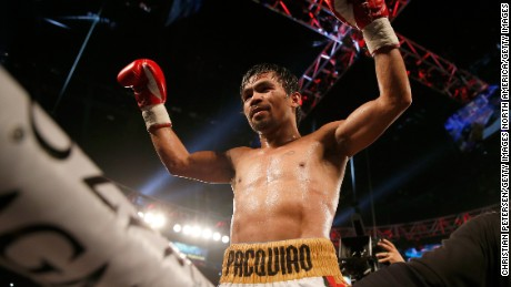 Manny Pacquiao celebrates after defeating Timothy Bradley Jr. by unanimous decision in their welterweight championship fight on April 9, 2016 at MGM Grand Garden Arena in Las Vegas, Nevada.
