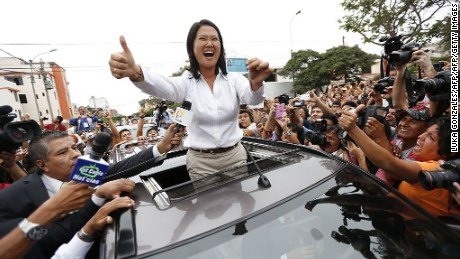 Peru´s presidential candidate Keiko Fujimori arrives at the polling station during general elections, in Lima on April 10, 2016  Almost 23 million Peruvians in Peru and abroad are expected to decide whether Keiko Fujimori, daughter of an ex-president jailed for massacres, should become their first female head of state in an election marred by alleged vote-buying and guerrilla attacks that killed four. / AFP / LUKA GONZALES        (Photo credit should read LUKA GONZALES/AFP/Getty Images)