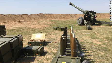 Iraqi military howitzers firing at ISIS' supply lines on the other side of the al-Nasir village.