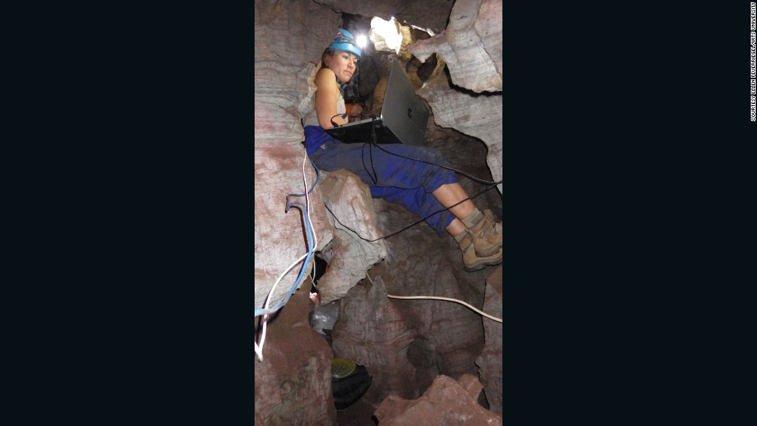 """It's damp, it's dark. If you slip in certain situations you can fall and injure yourself,"" explained Berger of Rising Star cave. Here, Lindsay Eaves manages to work on a laptop inside the cramped cave."