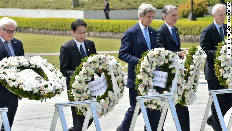 Germany's Foreign Minister Frank-Walter Steinmeier, Japan's Foreign Minister Fumio Kishida, US Secretary of State John Kerry, British Foreign Secretary Philip Hammond and Canada's Foreign Minister Stephane Dion offer wreaths at the Memorial Cenotaph for the 1945 atomic bombing victims in the Peace Memorial Park, on the sidelines of the G7 Foreign Ministers' Meeting in Hiroshima on April 11, 2016. Kerry and other G7 foreign ministers made the landmark visit on April 11 to the memorial site for the world's first nuclear attack in Hiroshima.   / AFP / POOL / Kazuhiro NOGI        (Photo credit should read KAZUHIRO NOGI/AFP/Getty Images)