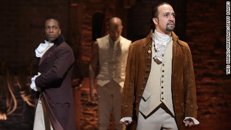 "Actor Leslie Odom Jr., left,  and actor-composer Lin-Manuel Miranda on stage during the ""Hamilton"" performance at the Grammys on February 15, 2016, in New York City."