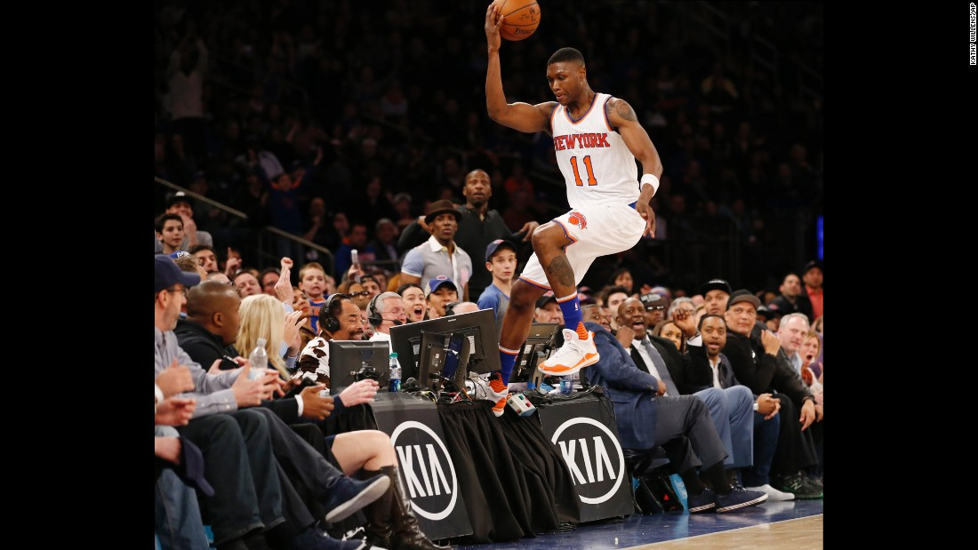 Cleanthony Early steps on a broadcast table as he tries to save a ball from going out of bounds Sunday, April 10, in New York.