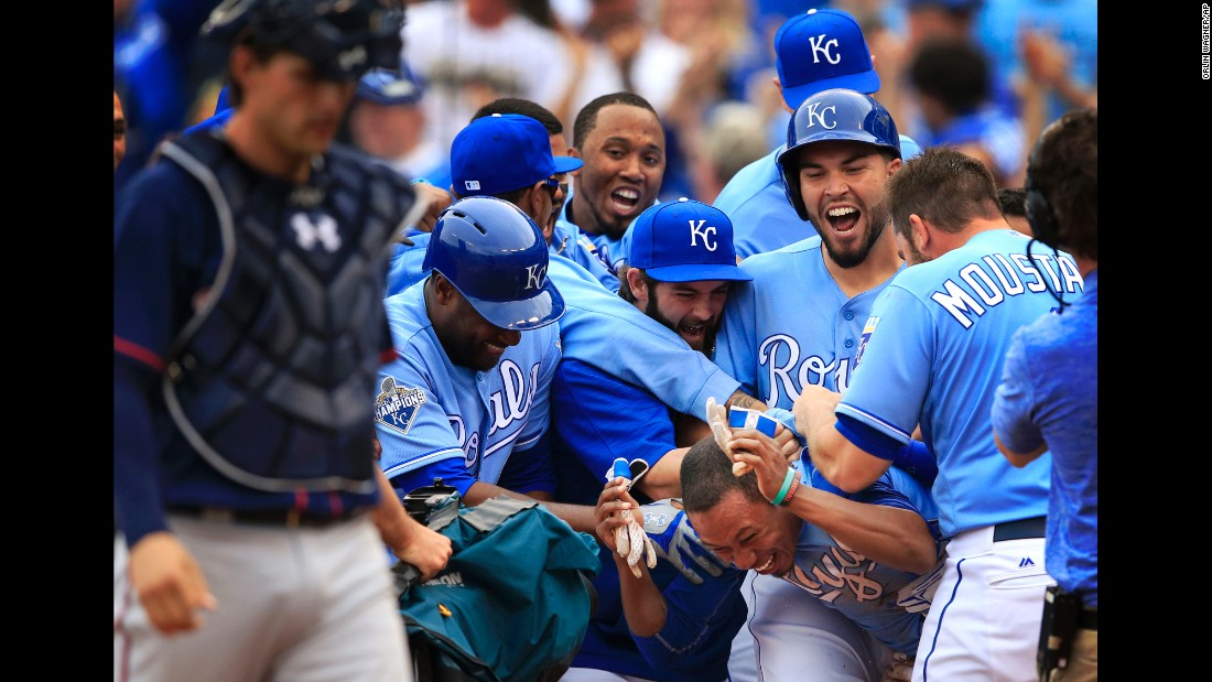 Kansas City Royals mob Terrance Gore after he scored the winning run against Minnesota on Sunday, April 10.