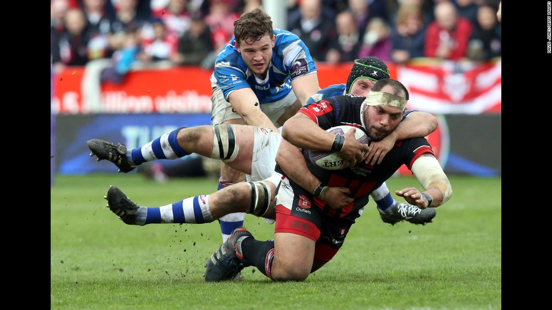 Gloucester Rugby's John Alofa is tackled by Nic Cudd of the Newport Gwent Dragons during a Challenge Cup match in Gloucester, England, on Saturday, April 9. The Dragons, who play in Newport, Wales, won 23-21 to advance to the semifinals of the European tournament.