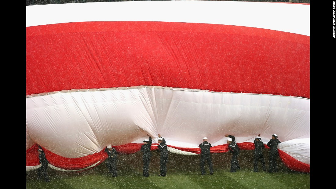 "U.S. sailors try to corral a large American flag before the home opener of the Chicago White Sox on Friday, April 8. <a href=""http://www.cnn.com/2016/04/05/sport/gallery/what-a-shot-sports-0405/index.html"" target=""_blank"">See 29 amazing sports photos from last week</a>"