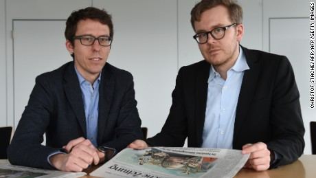 "German journalists Bastian Obermayer (R) and Frederik Obermaier (L) co-authors of the socalled ""Panama Papers"" investigation pose on April 7, 2016 in Munich, southern Germany, at the office of the German daily ""Sueddeutsche Zeitung"". The Panama Papers are a massive leak of 11.5 million documents allegedly exposing the secret offshore dealings of aides to Russian president Vladimir Putin, world leaders and celebrities including Barcelona striker Lionel Messi. The vast stash of records was obtained from an anonymous source by German daily Sueddeutsche Zeitung and shared with media worldwide by the International Consortium of Investigative Journalists (ICIJ).  / AFP / CHRISTOF STACHE        (Photo credit should read CHRISTOF STACHE/AFP/Getty Images)"