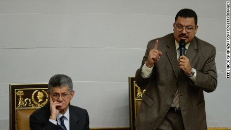 The second vice-president Simon Calzadilla (R) delivers a speech next to the president of the Venezuelan National Assembly, Henry Ramos Allup (L), during a session in Caracas on March 17, 2016. The Venezuelan parliament rejected Thursday to extend for 60 more days the economic emergency decree issued by Venezuelan President Nicolas Maduro past January 14. AFP PHOTO/FEDERICO PARRA / AFP / FEDERICO PARRA        (Photo credit should read FEDERICO PARRA/AFP/Getty Images)