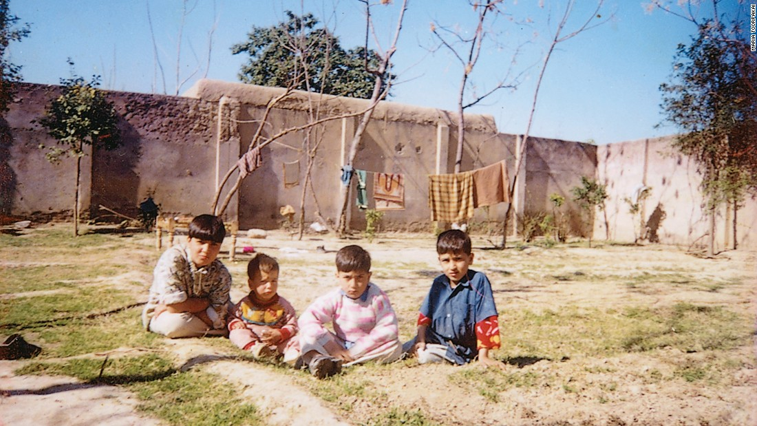 "Sitting in the dirt in Darra Adam Khel. Maria is the ""boy"" on the far left -- she called herself ""Changez Khan"" to compete as a male in weightlifting."