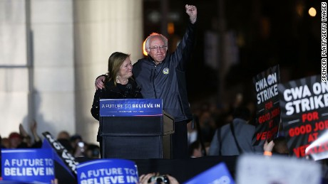 Bernie Sanders stands on stage with his wife Jane O'Meara Sanders before speaking to thousands of people at a rally for in New York City's historic Washington Square Park on April 13, 2016 in New York City.